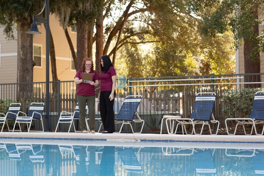 Community managers inspecting pool